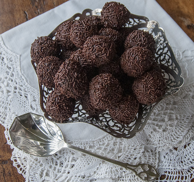 These luscious chocolate truffles are covered with INDIA TREE Chocolate Vermicelli. They have a creamy texture, and a rich flavor with a touch of sea salt as counterpoint. They are simple to make and do nor require coating in tempered chocolate. They would make a lovely holiday treat or hostess gift any time of year.