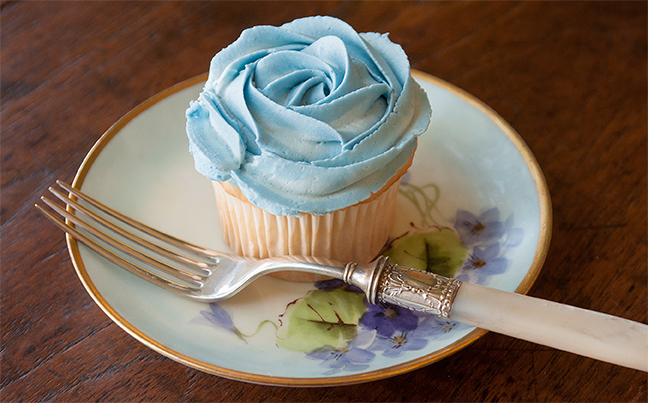 For that special occasion, a Cupcake topped with a swirl of Creamed Frosting tinted with INDIA TREE Nature's Colors Blue Decorating Color.