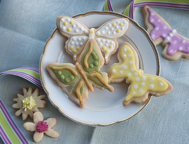 This recipe is for larger cookies. The dough is firmer, preventing the cookie from spreading in the pan during baking or breaking into pieces during decorating. The perfect choice for these intricately shaped butterflies, flooded and piped with Royal Icing tinted with INDIA TREE Nature's Colors Decorating Colors.