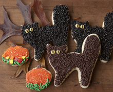These adorable scaredy cat cookies are made with our Shortbread Cutout Cookies Recipe, flooded with Royal Icing, which has been tinted a dark color by adding drops from each color in the INDIA TREE Nature's Colors Decorating Set, and flocked with INDIA TREE Decoratifs.