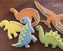 Perfect for back-to-school: playful Dinosaur Shortbread Cookies, imaginatively decorated with our INDIA TREE Nature's Colors Decorating Set.