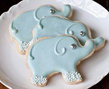 These Elephant Shortbread Cookies are sure to delight the child in everyone, yet are sophisticated enough to be served at a shower, a reception, or a tea. A simple recipe that creates melt-in-your-mouth results, Shortbread Cookies made with INDIA TREE Fondant and Icing Sugar keep their shape as they bake. These are decorated with Royal Icing, tinted with INDIA TREE Nature's Colors, INDIA TREE Nature's Colors String of Pearls and INDIA TREE French Dragées.