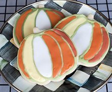 Pumpkin Cookies are a sweet and beautful treat for a fall feast or Halloween party. Make them with our Shortbread Cookie Recipe and flood with Royal Icing tinted with INDIA TREE Nature's Colors Decorating Set.