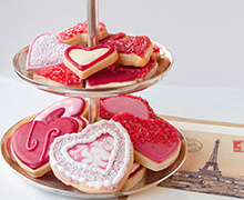 Flood heart-shaped Shortbread Cookies with Royal Icing in varying shades of INDIA TREE TrueRed. Flock them with INDIA TREE Nature's Colors Decorating Sugars and Party Decoratifs.