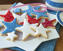 These dazzling star-shaped Shortbread Cookies are a fun and easy addition to any party table. Cut stars out of our Shortbread Cookie Recipe and flood with Royal Icing Flock with INDIA TREE sugars and decoratifs.