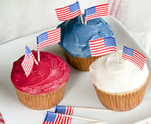 A super easy way to celebrate Independence day with red, white, and blue cupcakes and minature flags. Use INDIA TREE Nature's Colors to tint the frosting.