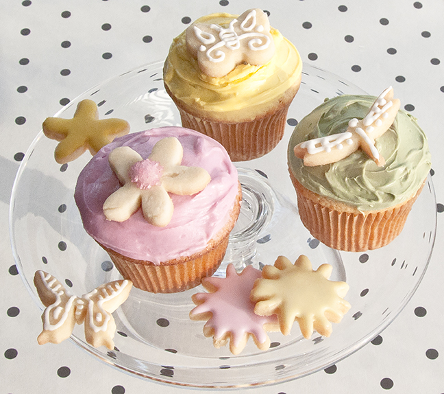Retro Cupcakes from the jukebox era. Slather them with Creamed Frosting tinted with INDIA TREE Nature's Colors Decorating Colors. Top them with miniature Shortbread Cookie cutouts.