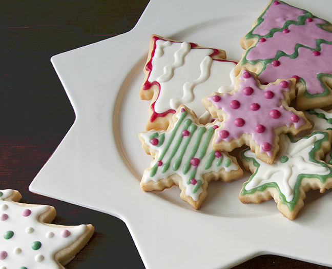 Have yourself a merry, pink and green Christmas with Sugar Cookies shaped as trees and stars, flooded and flocked with Royal Icing tinted with INDIA TREE Nature's Colors Decorating Colors.  See our Royal Icing Color Guide for instructions on how to mix color to achieve a true Christmas red and green.