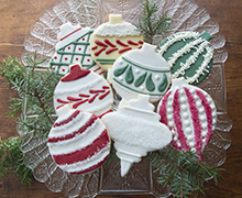 Thrift shop Vintage Christmas Tree Ornaments were the inspiration for these large shortbread cookies cut from wax paper patterns and decorated with Royal Icing tinted with INDIA TREE Nature's Colors Decorating Colors.