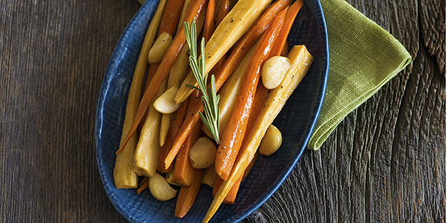 Oven braising the carrots and parsnips in mulling-spiced orange juice and aromatics gives them a sweet flavorful glaze. Serve this fall side dish with roast chicken, turkey, pork or beef.