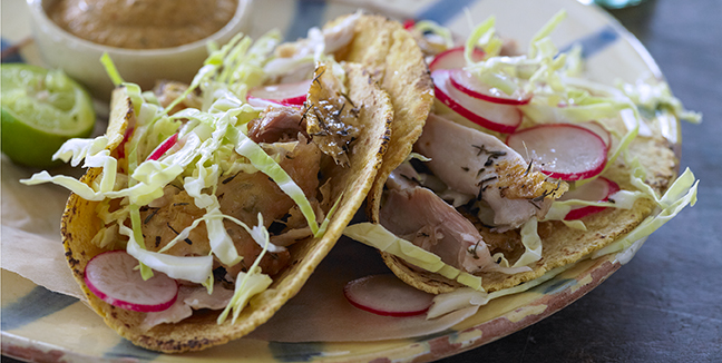 These chicken tacos are a great idea for a family meal or informal dinner. The diners can make their own tacos. INDIA TREE Chiles de Arbol and minced canned chipotle, add heat and distinctive flavor to the Salsa. The fixings can be prepared ahead of time.
