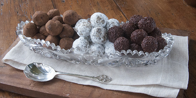 These luscious chocolate truffles are three variations on the same recipe.  They have a creamy texture, and a rich flavor with a touch of sea salt as counterpoint. They are simple to make and do not require coating in tempered chocolate.  They would make a lovely holiday treat or hostess gift any time of year.