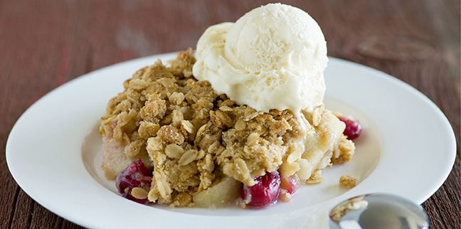 Always a comforting dessert, fruit crumble is enhanced with fresh cranberries and mulled cider, providing just the right balance to bring out the best apple flavor.
