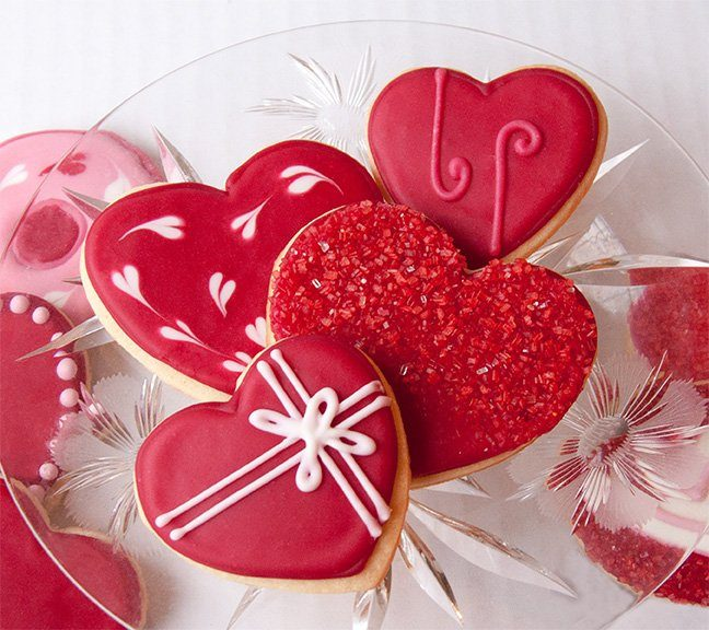 Flood heart-shaped Shortbread Cookies with Royal Icing in deep shades of INDIA TREE Nature's Colors TrueRed Decorating Color. Flock them with INDIA TREE Nature's Colors Decorating Sugars. Valentine cookies don't get any sweeter than these shortbread hearts.